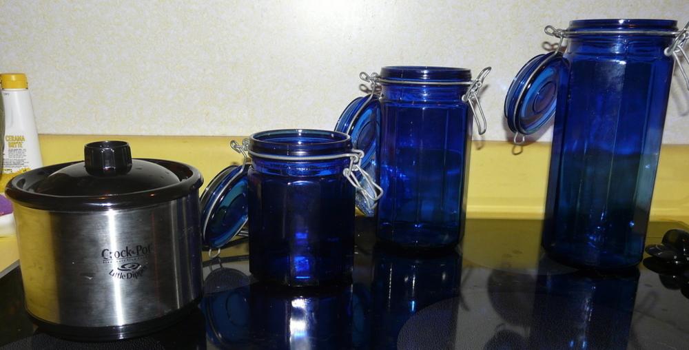 Three insanely blue jars and one teeny tiny crock pot.